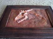 Dragon skull fossil sculpture in a frame, bottom view