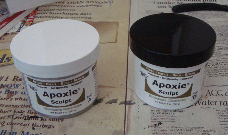 Apoxie Sculpt epoxy putty part A and B containers