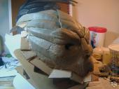Adding cardboard around the base of the sculpture