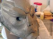 Adding a clay barrier around the base of the sculpture