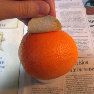 Peeling dry latex off of the orange