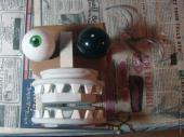 Cardboard puppet mouth with teeth and eyeballs