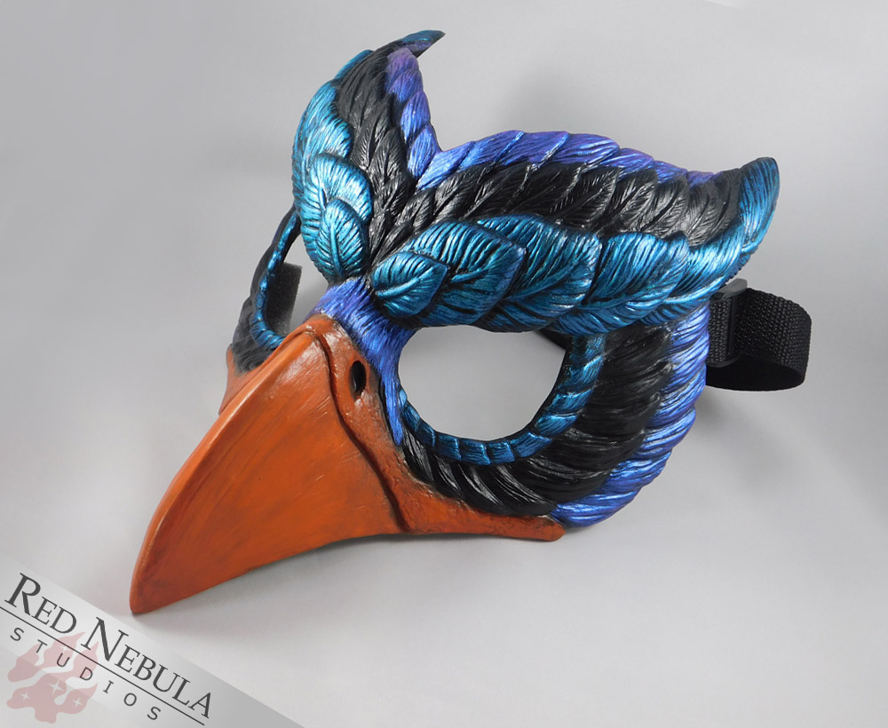 Painted griffon mask in orange, blue, purple, and black