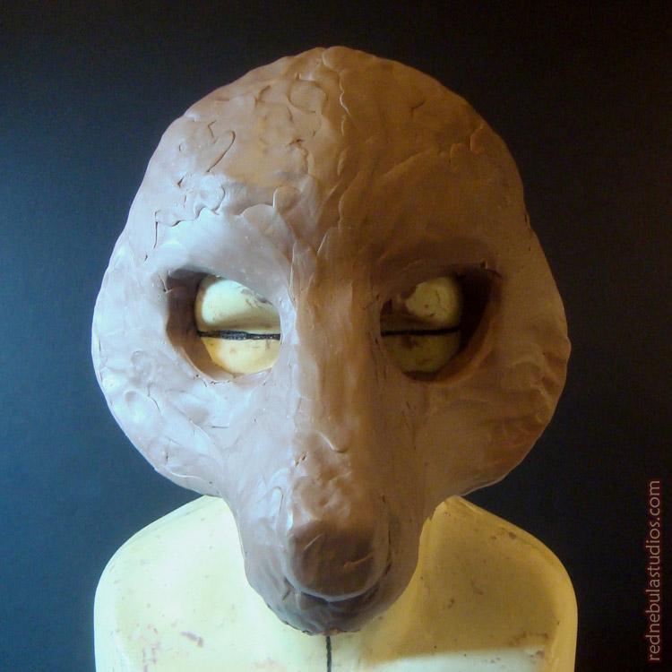 Stylized wolf mask sculpture in progress