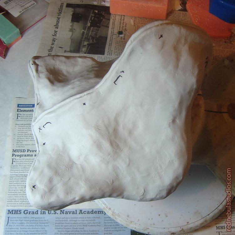 Stylized wolf mask mold in progress